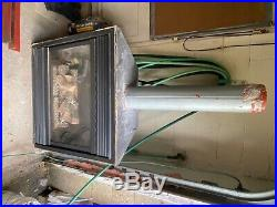 Gas fireplace insert with glass front and logs