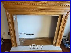 Monessen Ventless fireplace with gas attachement, logs, and Oak Mantle